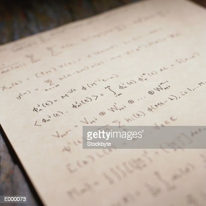 Paper with mathematical formulae written on it : Stock Photo