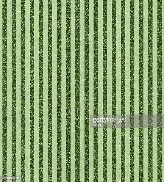 paper with vertical green glitter stripes