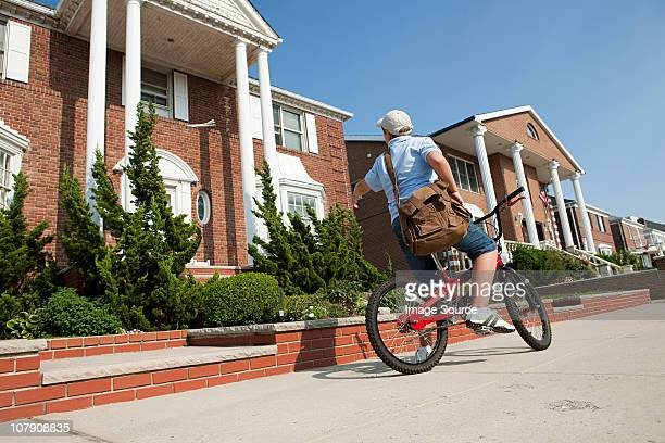 Paperboy with bike throwing newspaper