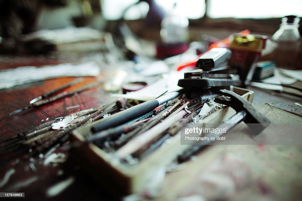 Paper-cut engraving tools on the table : Stock Photo