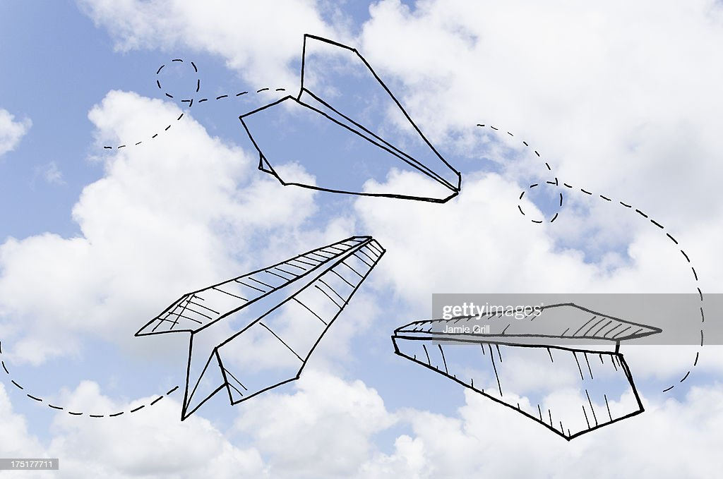 Paperplanes drawn on cloudy sky