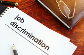 Papers about job discrimination on a desk.