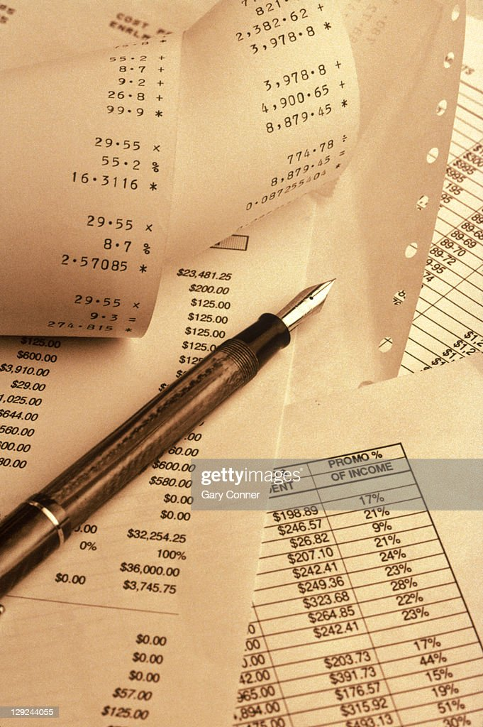 Papers, adding machine tape and fountain pen : Stock Photo
