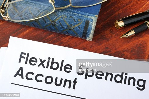 Papers with flexible spending account FSA on a table. : Stock Photo