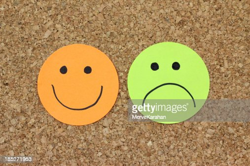 Papers with happy and sad faces : Stock Photo