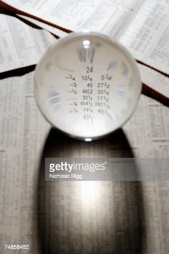 Paperweight on financial newspaper, elevated view
