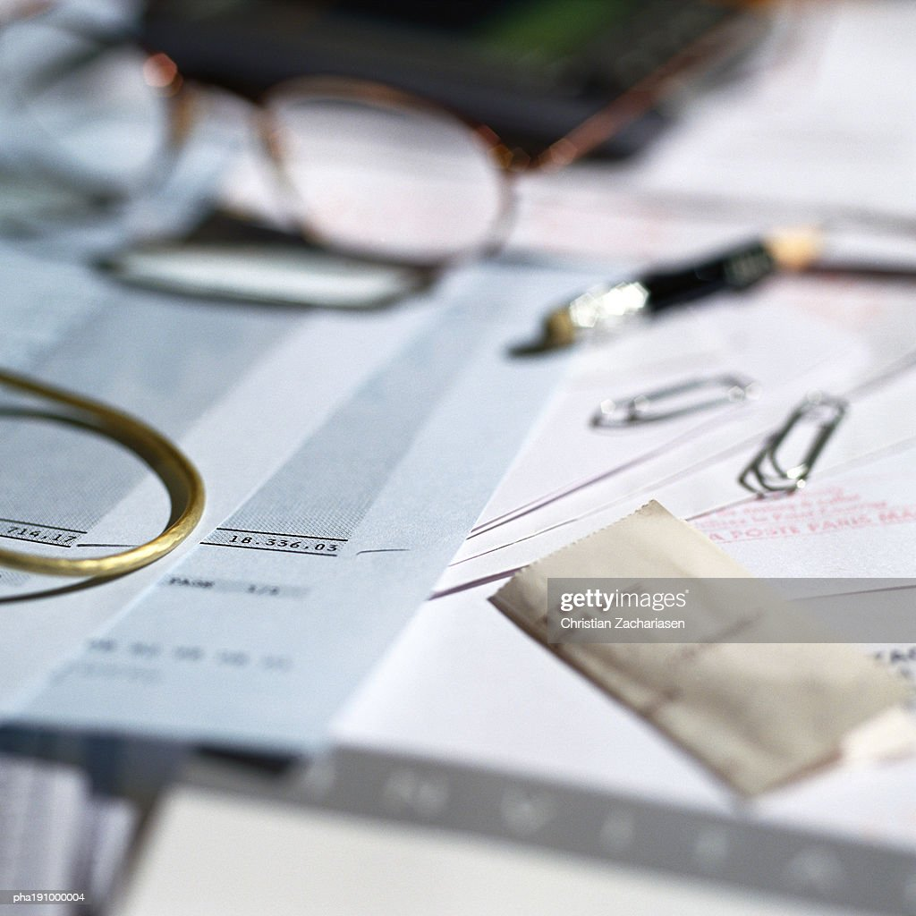 Paperwork, glasses and office materials lying on desk. : Stock Photo