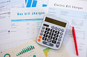 Energy efficiency concept with charges invoice documents on desk