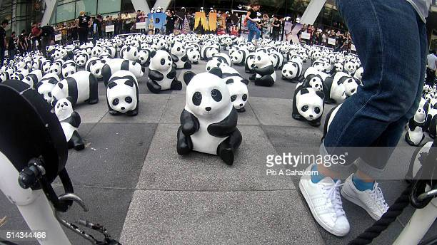 1600 papiermache pandas created by French artist Paulo Grangeon displayed at Central World Shopping Center the 1600 paper mache pandas is a message...