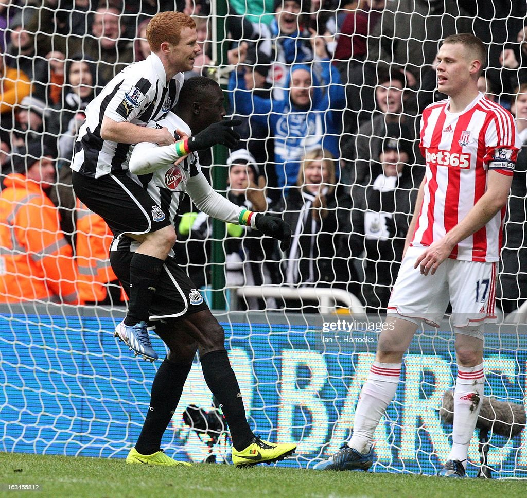 Papis Cisse celebrates scoring the winning goal for Newcastle United with Adam Campbell on his back during the Barclays Premier League match between Newcastle United and Stoke City on March 10, 2013 at St James' Park in Newcastle upon Tyne, England.