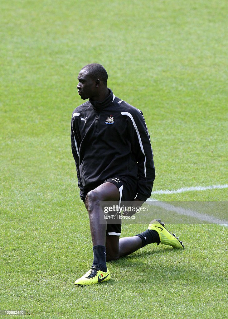 Papis Cisse looks on during a Newcastle United training session at St James' Park on April 19, in Newcastle upon Tyne, England.