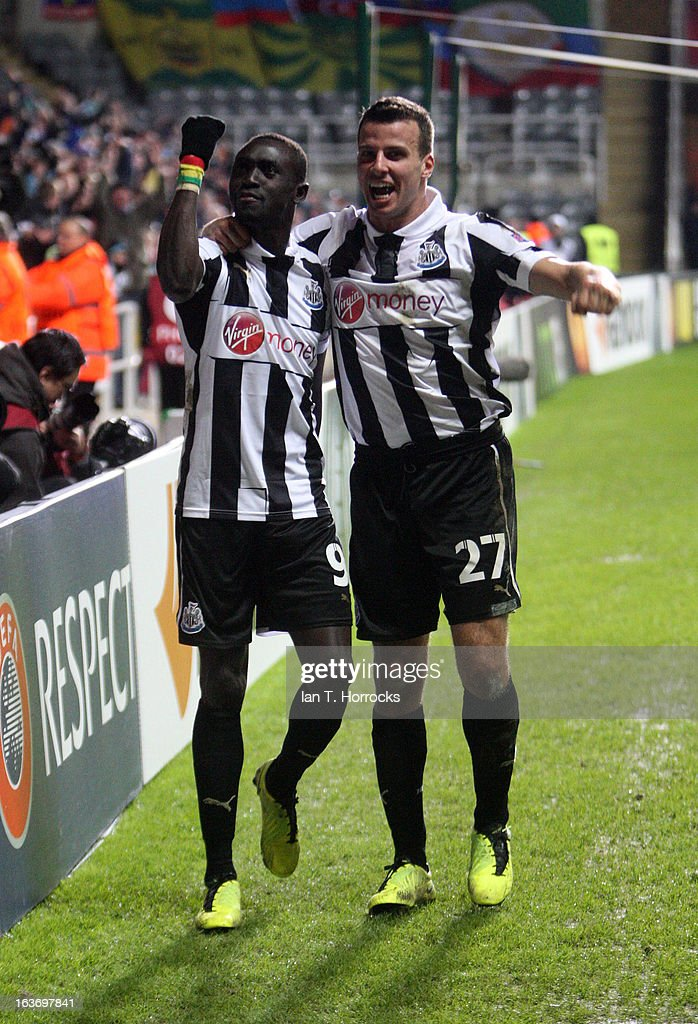 Papis Cisse of Newcastle United celebrates with Steven Taylor after scoring the only goal during the UEFA Europa League Round of 16 second leg match...