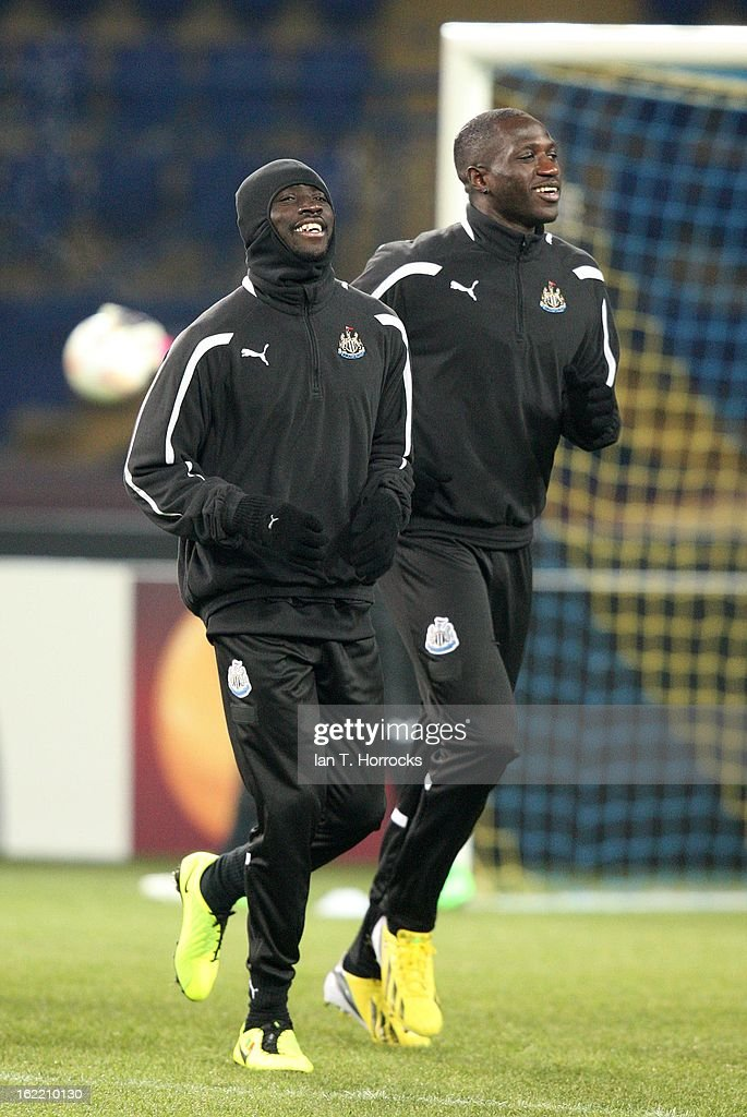 Papis Cisse of Newcastle United FC with Moussa Sissoko (right) during a training session ahead of their UEFA Europa League round of 32 second leg match against FC Metalist Kharkiv, at Metalist Stadium, on February 20, 2013 in Kharkov, Ukraine.