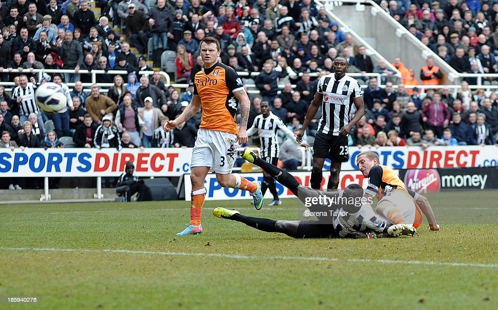Papis Cisse of Newcastle United scores the only goal during the Barclays Premier League match between Newcastle United and Fulham at St James' Park on April 07, 2013 in Newcastle upon Tyne, England.