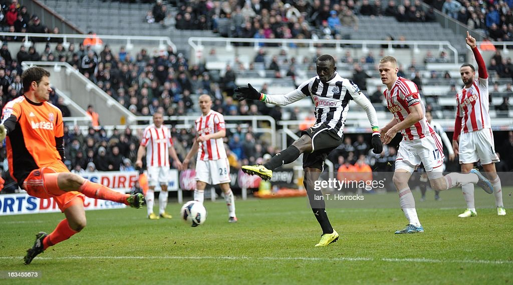Papis Cisse scores the winning goal for Newcastle United during the Barclays Premier League match between Newcastle United and Stoke City on March 10, 2013 at St James' Park in Newcastle upon Tyne, England.