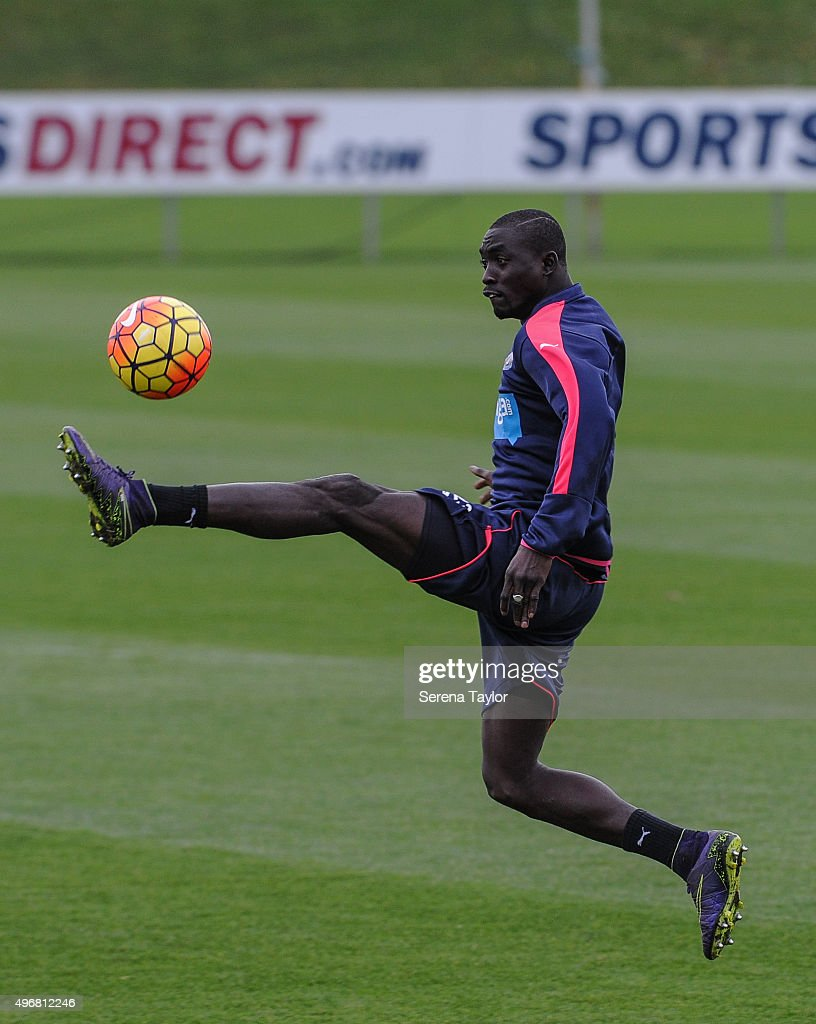 Papiss Cisse (R) controls the ball mid air during the Newcastle United Training session at The Newcastle United Training Centre on November 12, 2015, in Newcastle upon Tyne, England.