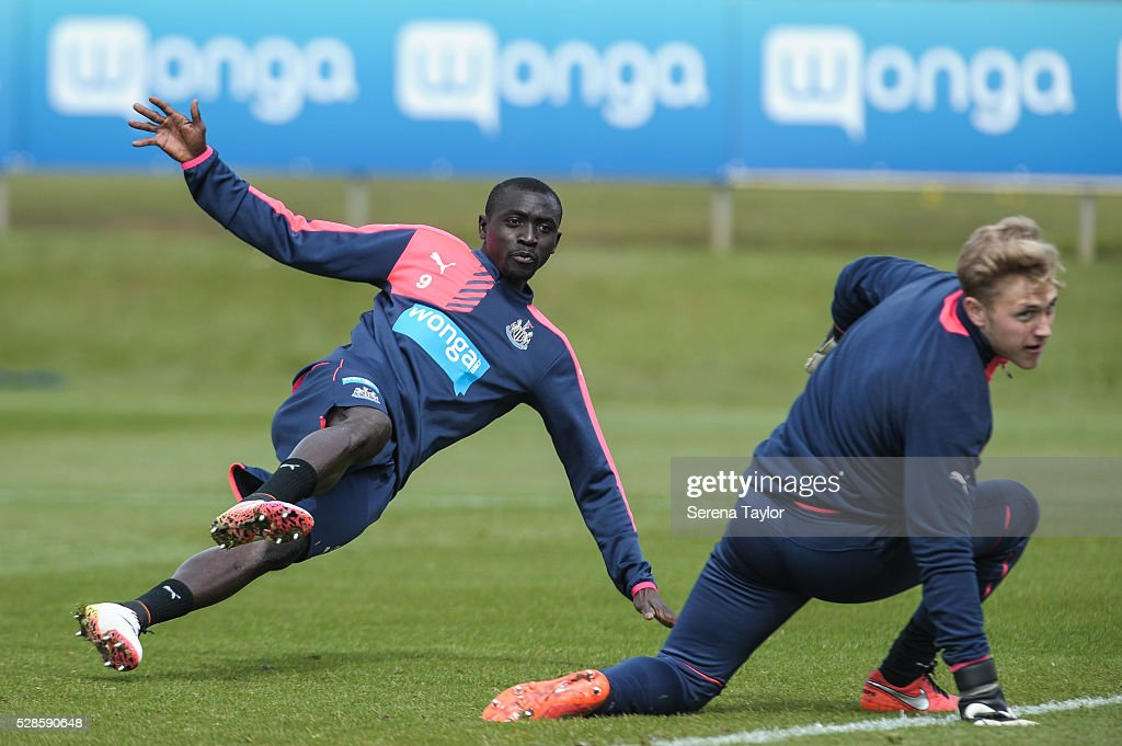 <a gi-track='captionPersonalityLinkClicked' href=/galleries/search?phrase=Papiss+Cisse&family=editorial&specificpeople=4251917 ng-click='$event.stopPropagation()'>Papiss Cisse</a> (L) falls after he strikes the ball during the Newcastle United Training session at The Newcastle United Training Centre on May 6, 2016, in Newcastle upon Tyne, England.