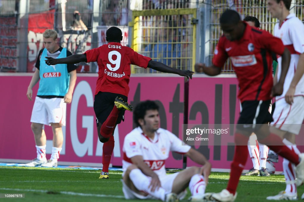 <a gi-track='captionPersonalityLinkClicked' href=/galleries/search?phrase=Papiss+Cisse&family=editorial&specificpeople=4251917 ng-click='$event.stopPropagation()'>Papiss Cisse</a> (L) of Freiburg celebrates his team's first goal as <a gi-track='captionPersonalityLinkClicked' href=/galleries/search?phrase=Serdar+Tasci&family=editorial&specificpeople=787688 ng-click='$event.stopPropagation()'>Serdar Tasci</a> of Stuttgart reacts during the Bundesliga match between SC Freiburg and VfB Stuttgart at the Badenova Stadium on September 11, 2010 in Freiburg im Breisgau, Germany.