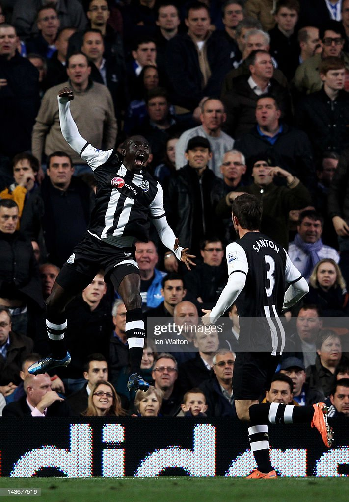 <a gi-track='captionPersonalityLinkClicked' href=/galleries/search?phrase=Papiss+Cisse&family=editorial&specificpeople=4251917 ng-click='$event.stopPropagation()'>Papiss Cisse</a> of Newcastle celebrates after scoring the opening goal with teammate <a gi-track='captionPersonalityLinkClicked' href=/galleries/search?phrase=Davide+Santon&family=editorial&specificpeople=5679382 ng-click='$event.stopPropagation()'>Davide Santon</a> (R) during the Barclays Premier League match between Chelsea and Newcastle United at Stamford Bridge on May 2, 2012 in London, England.