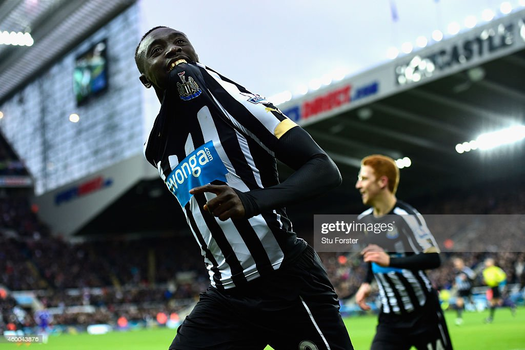 Papiss Cisse of Newcastle (r) celebrates after scoring the opening goal during the Barclays Premier League match between Newcastle United and Chelsea at St James' Park on December 6, 2014 in Newcastle upon Tyne, England.