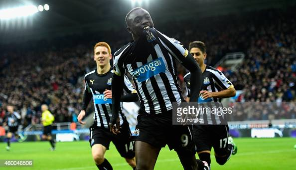 Papiss Cisse of Newcastle celebrates after scoring the opening goal during the Barclays Premier League match between Newcastle United and Chelsea at...