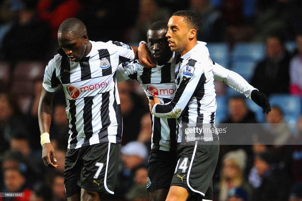 Papiss Cisse of Newcastle celebrates scoring to make it 1-0 with team mates Moussa Sissoko and James Perch during the Barclays Premier League match between Aston Villa and Newcastle United at Villa Park on January 29, 2013 in Birmingham, England.