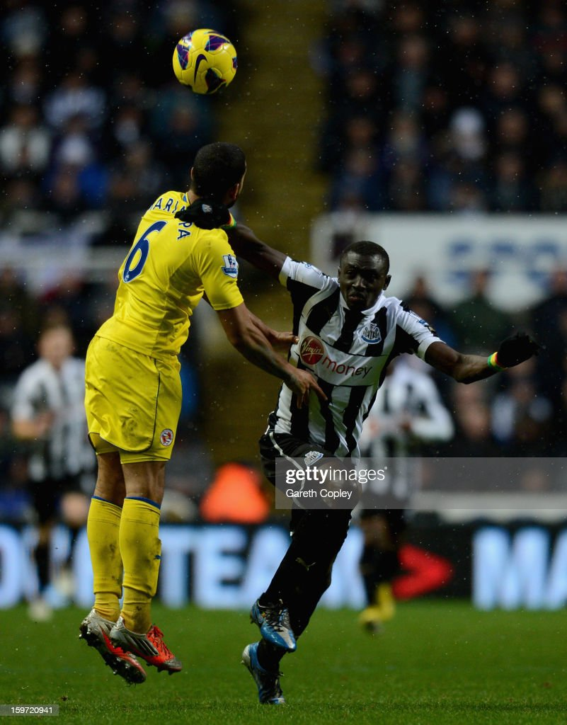 <a gi-track='captionPersonalityLinkClicked' href=/galleries/search?phrase=Papiss+Cisse&family=editorial&specificpeople=4251917 ng-click='$event.stopPropagation()'>Papiss Cisse</a> of Newcastle is tackled by Adrain Mariappa of Reading during the Barclays Premier League match between Newcastle United and Reading at St James Park on January 19, 2013 in Newcastle upon Tyne, England.