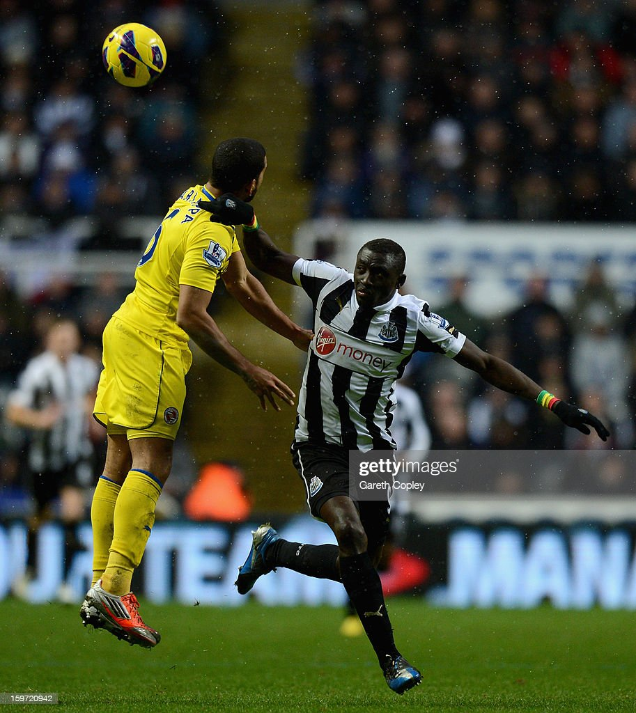 Papiss Cisse of Newcastle is tackled by Adrain Mariappa of Reading during the Barclays Premier League match between Newcastle United and Reading at St James Park on January 19, 2013 in Newcastle upon Tyne, England.
