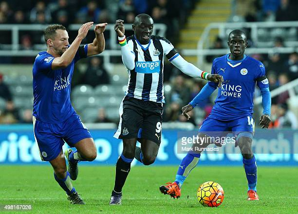 Papiss Cisse of Newcastle is tracked by Danny Drinkwater and N'Golo Kante of Leicester during the Barclays Premier League match between Newcastle...