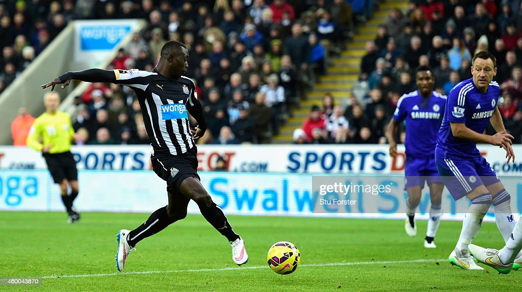 Papiss Cisse of Newcastle scores the opening goal during the Barclays Premier League match between Newcastle United and Chelsea at St James' Park on...