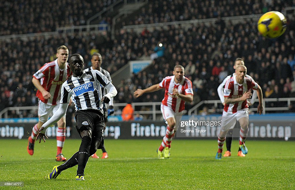 Papiss Cisse of Newcastle scores their fifth goal from the penalty spot during the Barclays Premier League match between Newcastle United and Stoke City at St. James' Park on December 26, 2013, in Newcastle upon Tyne England.