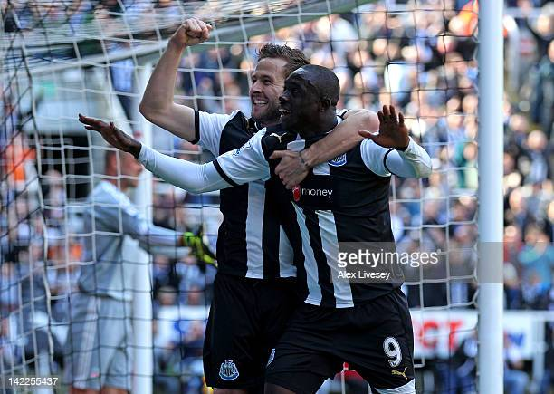Papiss Cisse of Newcastle United celebrates scoring the opening goal with team mate Yohan Cabaye during the Barclays Premier League match between...