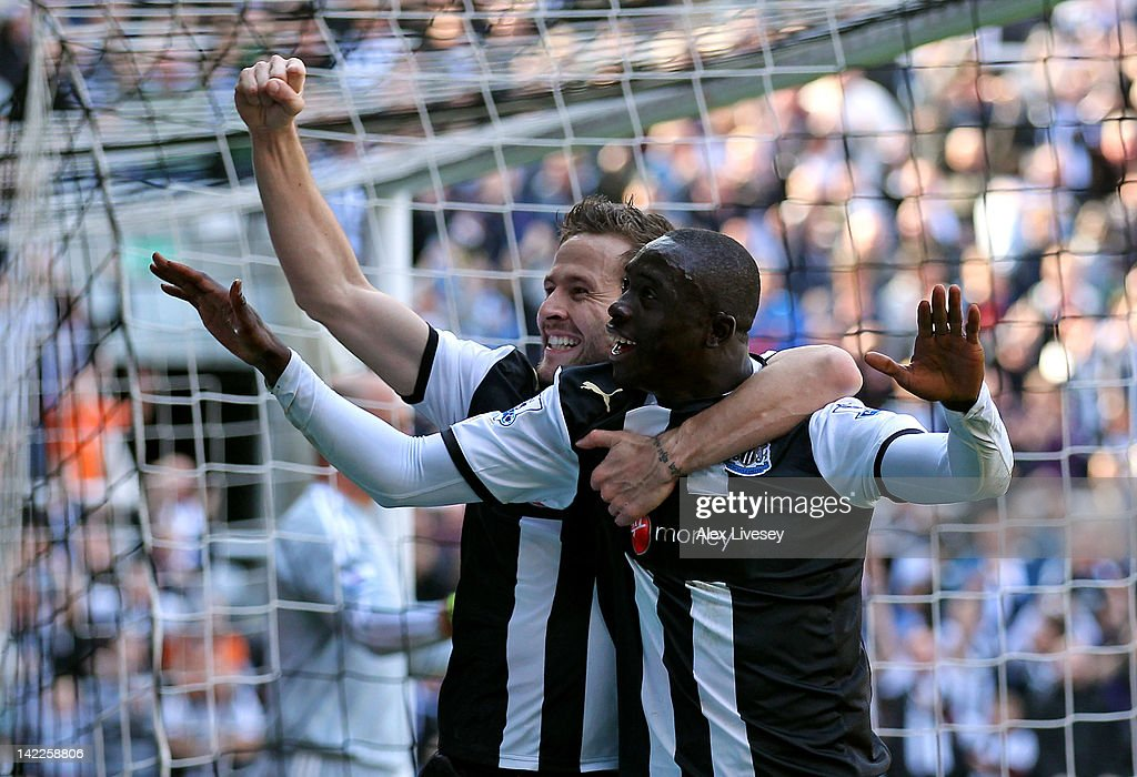Papiss Cisse of Newcastle United celebrates scoring the opening goal with team mate Yohan Cabaye (L) during the Barclays Premier League match between Newcastle United and Liverpool at Sports Direct Arena on April 1, 2012 in Newcastle upon Tyne, England.
