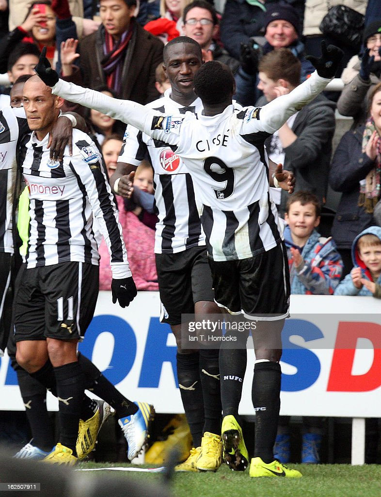 <a gi-track='captionPersonalityLinkClicked' href=/galleries/search?phrase=Papiss+Cisse&family=editorial&specificpeople=4251917 ng-click='$event.stopPropagation()'>Papiss Cisse</a> of Newcastle United (R) celebrates scoring the second Newcastle goal during the Barclays Premier League match between Newcastle United and Southampton at St James' Park on February 24, 2013 in Newcastle upon Tyne, England.