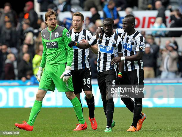 Papiss Cisse of Newcastle United celebrates with teammates Tim Krul Paul Dummett and Cheick Tiote after scoring a late goal during the Barclays...
