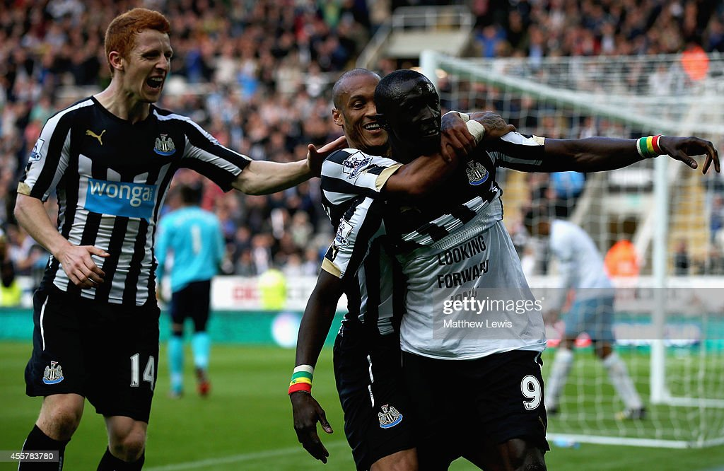 Papiss Cisse of Newcastle United is congratulated on his second goal during the Barclays Premier League match between Newcastle United and Hull City at St James' Park on September 20, 2014 in Newcastle upon Tyne, England.