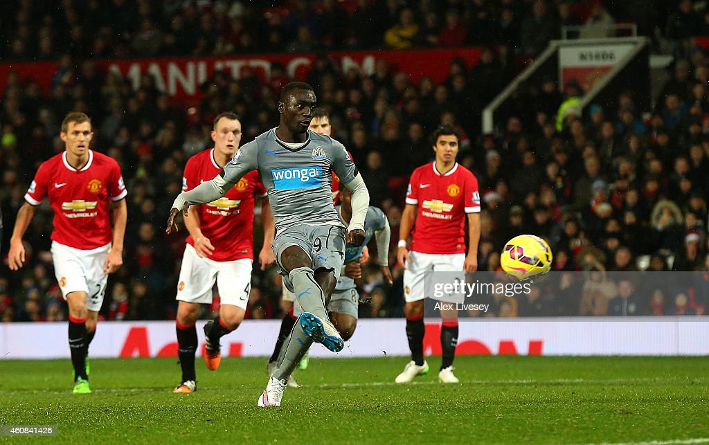 <a gi-track='captionPersonalityLinkClicked' href=/galleries/search?phrase=Papiss+Cisse&family=editorial&specificpeople=4251917 ng-click='$event.stopPropagation()'>Papiss Cisse</a> of Newcastle United scores his team's first goal from a penalty during the Barclays Premier League match between Manchester United and Newcastle United at Old Trafford on December 26, 2014 in Manchester, England.