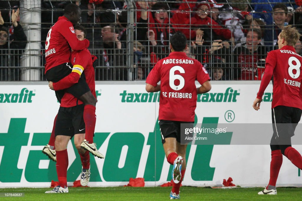 Papiss Demba Cisse of Freiburg celebrates his team's third goal with team mates <a gi-track='captionPersonalityLinkClicked' href=/galleries/search?phrase=Heiko+Butscher&family=editorial&specificpeople=683649 ng-click='$event.stopPropagation()'>Heiko Butscher</a>, <a gi-track='captionPersonalityLinkClicked' href=/galleries/search?phrase=Yacine+Abdessadki&family=editorial&specificpeople=815248 ng-click='$event.stopPropagation()'>Yacine Abdessadki</a> and <a gi-track='captionPersonalityLinkClicked' href=/galleries/search?phrase=Jan+Rosenthal&family=editorial&specificpeople=758564 ng-click='$event.stopPropagation()'>Jan Rosenthal</a> (L-R) during the Bundesliga match between SC Freiburg and Borussia M'gladbach at Badenova Stadium on December 12, 2010 in Freiburg im Breisgau, Germany.
