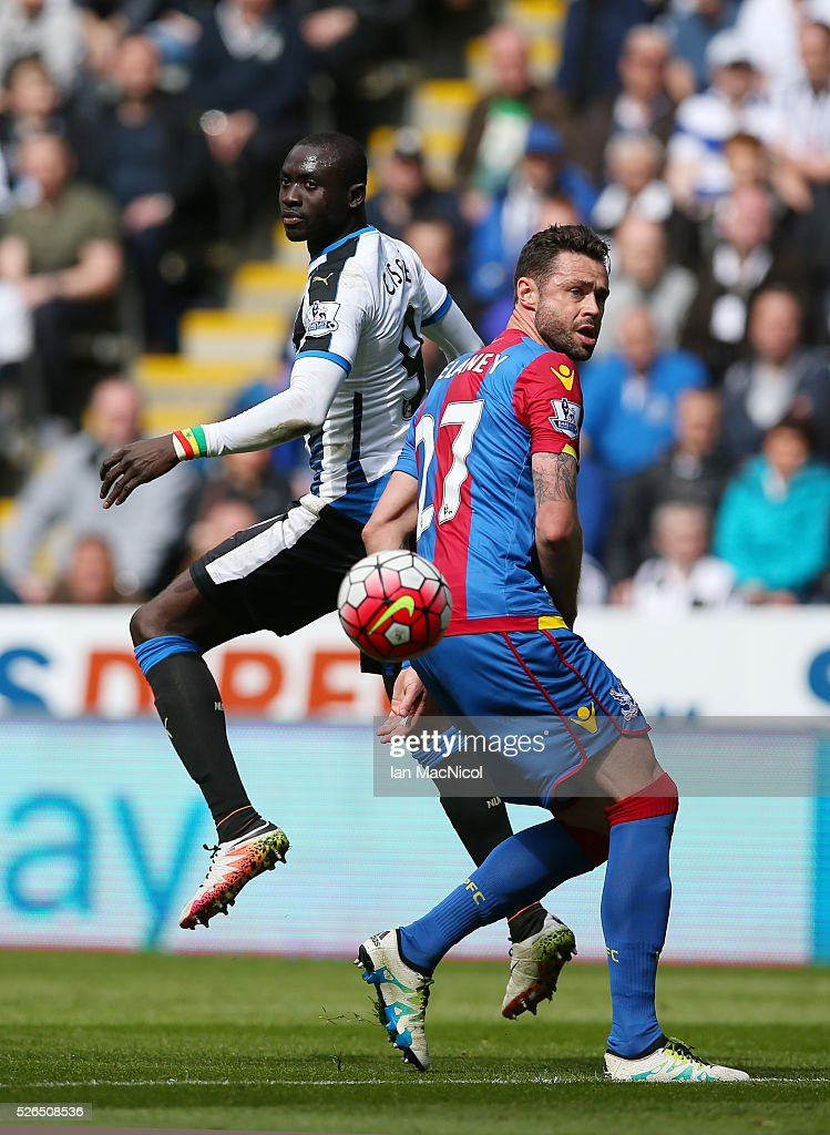 Papiss Demba Cisse of Newcastle United and Damien Delaney of Crystal Palace compete for the ball during the Barclays Premier League match between Newcastle United and Crystal Palace at St James' Park on April 30, 2016 in Newcastle upon Tyne, England.