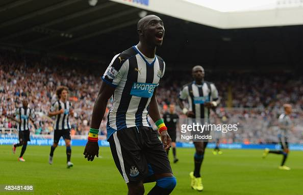 Papiss Demba Cisse of Newcastle United celebrates as he scores their first and equalising goal during the Barclays Premier League match between...