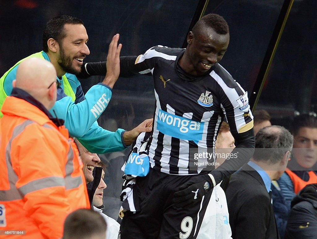 Papiss Demba Cisse of Newcastle United (R) celebrates scoring the opening goal with <a gi-track='captionPersonalityLinkClicked' href=/galleries/search?phrase=Jonas+Gutierrez&family=editorial&specificpeople=771739 ng-click='$event.stopPropagation()'>Jonas Gutierrez</a> of Newcastle United during the Barclays Premier League match between Newcastle United and Aston Villa at St James' Park on February 28, 2015 in Newcastle upon Tyne, England.