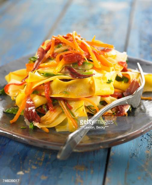 Pappardelles with vegetables and raw ham