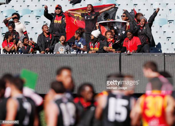 Papua New Guinea fans celebrate the win during the 2017 AFL International Cup Grand FInal match between New Zealand and Papua New Guinea at Melbourne...