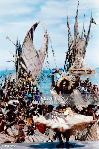 Papua New Guinea natives in traditional dress parade in Port Moresby on September 18 1995 as part of the Papua New Guinea's 20th anniversary of...