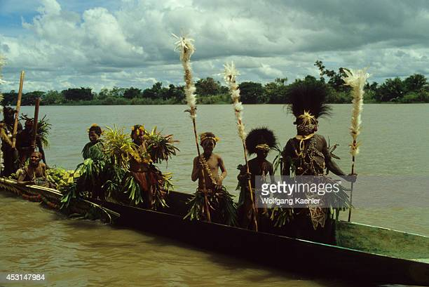 Papua New Guinea Sepik River Traditional War Canoe With Ceremonialdressed Tribesmen