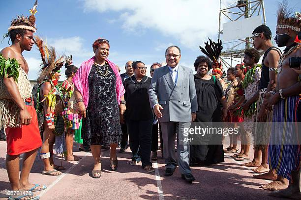 Papua New Guinea's Prime Minister Peter O'Neill arrives to participate in a national 'haus krai' day of mourning in Port Moresby on May 15 2013...
