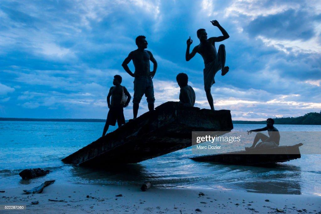Papuan men on an old bridge