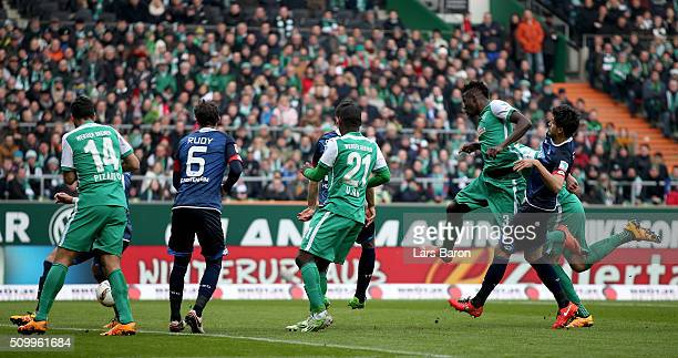 Papy Djilobodji of Bremen scores his teams first goal during the Bundesliga match between Werder Bremen and 1899 Hoffenheim at Weserstadion on...