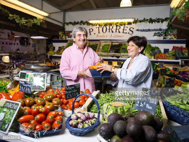 Paquita and Alain TORRES hold their fruit and vegetable stand at the Cap Ferret market on july 06 2017 in Cap Ferret France