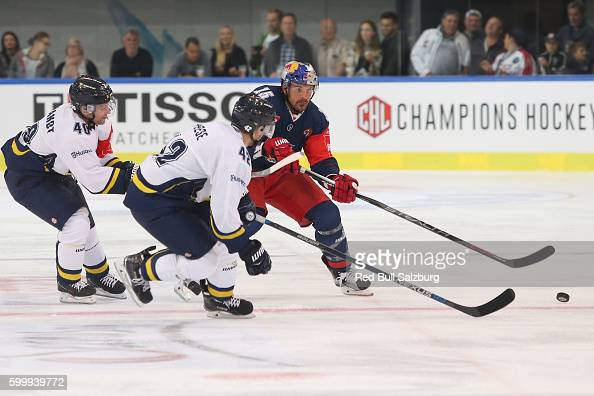 Par Arlbrandt and Dylan Reese of HV71 Jonkoping and Manuel Latusa of EC Red Bull Salzburg during the Champions Hockey League match between Red Bull...
